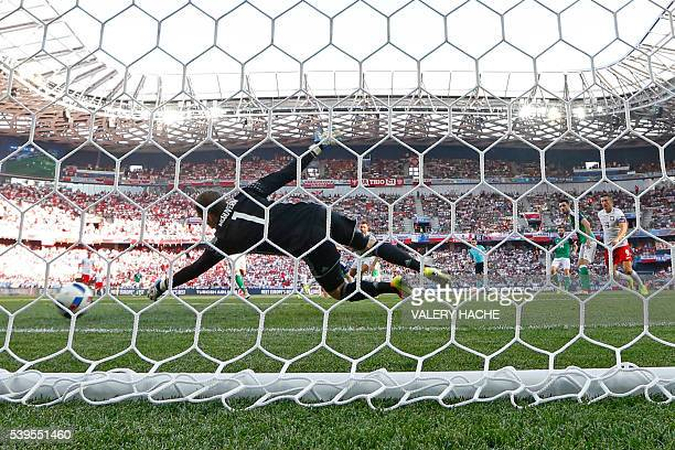 Northern Ireland's goalkeeper Michael McGovern fails to stop the ball during the Euro 2016 group C football match between Poland and Northern Ireland...