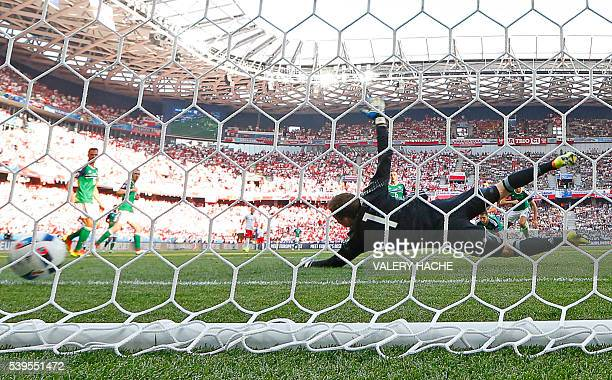 TOPSHOT Northern Ireland's goalkeeper Michael McGovern fails to stop the ball during the Euro 2016 group C football match between Poland and Northern...
