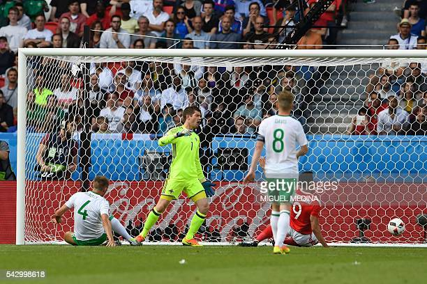 Northern Ireland's goalkeeper Michael McGovern reacts after Northern Ireland's defender Gareth McAuley scores an own goal during the Euro 2016 round...