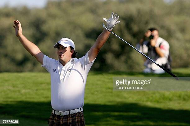 Northern Ireland's Graeme McDowell celebrates after holing his second shot for an albatross on the par 5, on the 17th hole during the final round of...