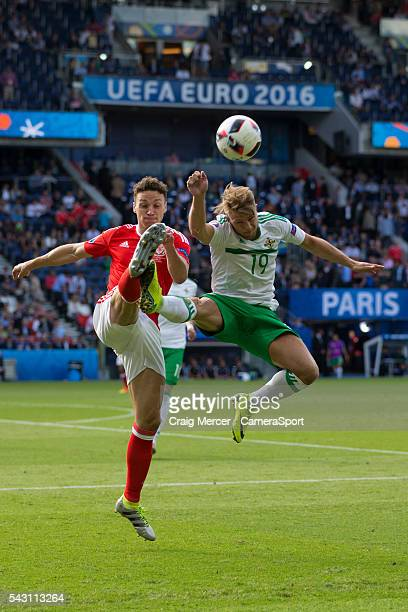 Northern Ireland's Jamie Ward battles for possession with Wales's James Chester during the UEFA Euro 2016 Round of 16 match between Wales and...