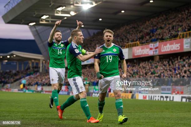 Northern Ireland's Jamie Ward celebrates with team mates after scoring the opening goal during the FIFA 2018 World Cup Qualifier between Northern...