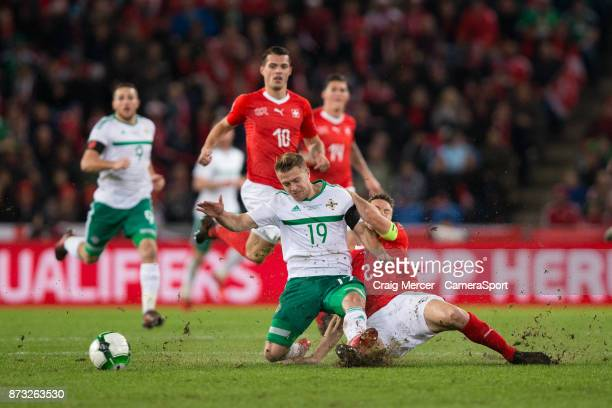 Northern Irelands Jamie Ward vies for possession with Switzerlands Stephan Lichtsteiner during the FIFA 2018 World Cup Qualifier PlayOff Second Leg...