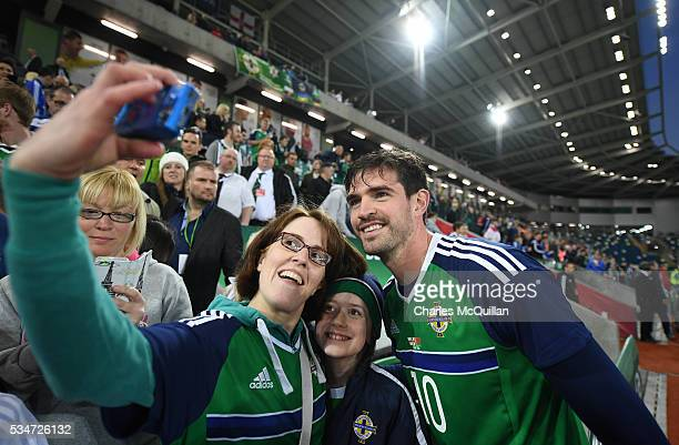 Northern Ireland's Kyle Lafferty has a selfie taken with fans after the international friendly game between Northern Ireland and Belarus on May 27...