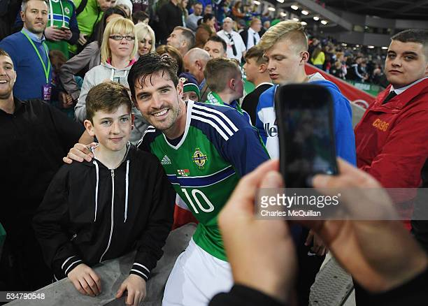 Northern Ireland's Kyle Lafferty poses with fans after the international friendly game between Northern Ireland and Belarus on May 27 2016 in Belfast...