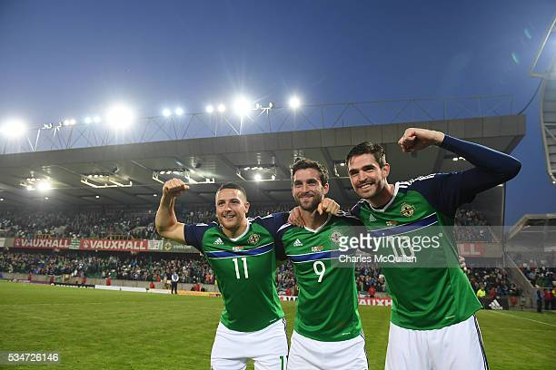 Northern Ireland's Kyle Lafferty Will Grigg and Conor Washington after the international friendly game between Northern Ireland and Belarus on May 27...