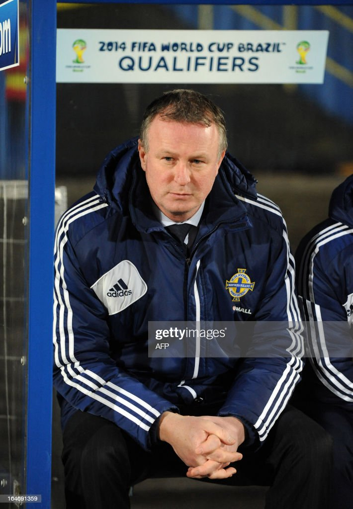 Northern Ireland's manager Michael O'Neill looks on from the dug out during the FIFA 2014 World Cup qualifying football match between Northern Ireland and Israel at Windsor Park in Belfast, Northern Ireland on March 26, 2013. Israel won the game 2-0. AFP PHOTO/MICHAEL COOPER