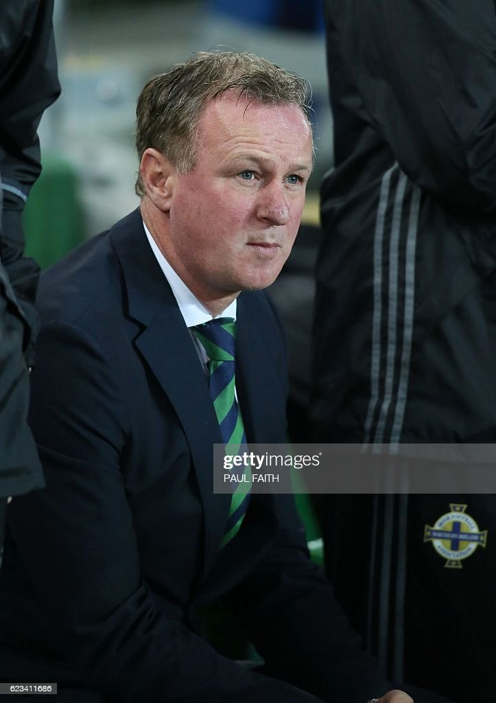 Northern Ireland's manager Michael O'Neill watches his players from the touchline during the friendly international football match between Northern Ireland and Croatia at Windsor Park in Belfast on November 15, 2016. / AFP / PAUL