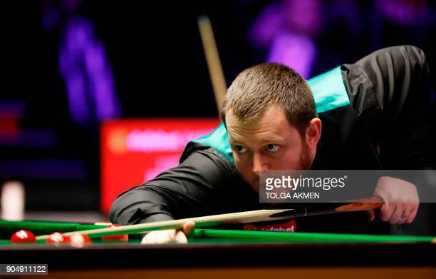 Northern Ireland's Mark Allen plays a shot during his firstround match against Belgium's Luca Brecel in the Masters snooker tournament at Alexandra...