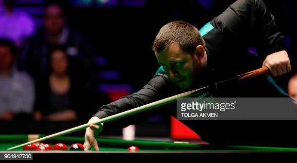 Northern Ireland's Mark Allen plays a shots against Belgium's Luca Brecel during their firstround match in the Masters snooker tournament at...