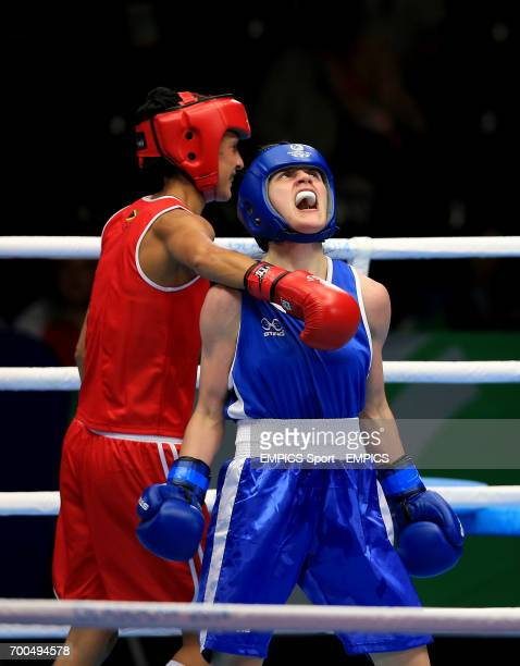 Northern Ireland's Michaela Walsh celebrates her win against Jamaica's Sarah Joy Rae in the Women's Fly Quarterfinal 1 at the SECC during the 2014...