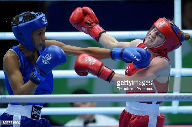 Northern Ireland's Michaela Walsh fights Mauritius' Thessa Dumas in the Fly event preliminaries at the SECC during the 2014 Commonwealth Games in...