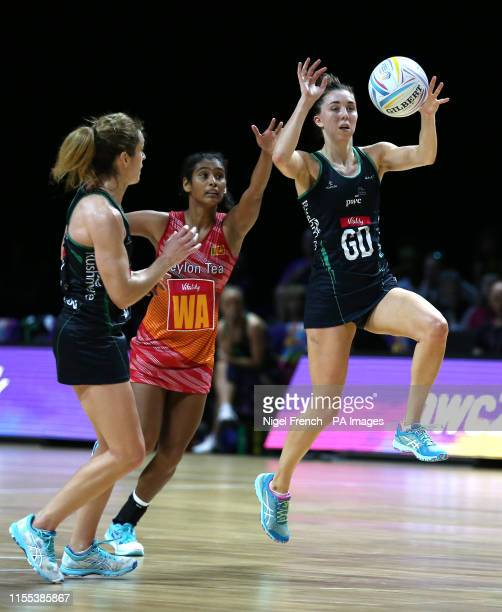 Northern Ireland's Michelle Magee and Sri Lanka's Dulangi Wannithileka battle for the ball during the Netball World Cup match at the M&S Bank Arena,...