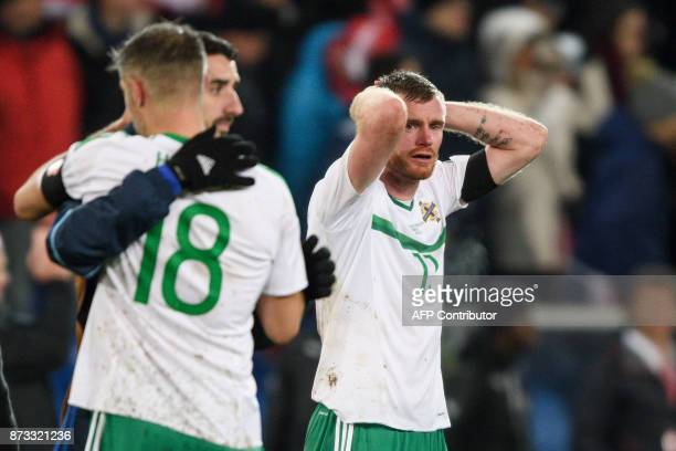 Northern Ireland's midfielder Chris Brunt reacts at the end of the FIFA 2018 World Cup playoff second leg qualifying football match between...