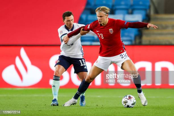 Northern Ireland's midfielder Corry Evans and Norway's forward Erling Braut Haaland vie for the ball during the UEFA Nations League football match...