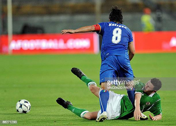 Northern Ireland's midfielder Corry Evans tackles Italian midfielder Gennaro Gattuso during their friendly football match on June 6 2009 at Arena...