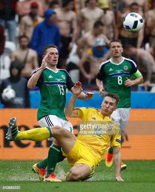 Northern Ireland's midfielder Corry Evans vies with Ukraine's midfielder Serhiy Sydorchuk during the Euro 2016 group C football match between Ukraine...