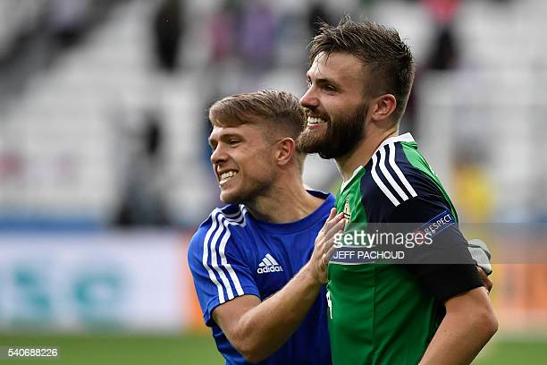 Northern Ireland's midfielder Jamie Ward and Northern Ireland's midfielder Stuart Dallas celebrate their team's win after the Euro 2016 group C...