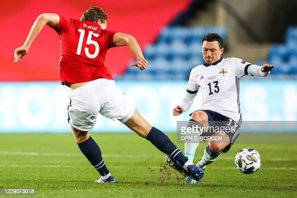 Northern Ireland's midfielder Jordan Thompson and Northern Ireland's midfielder Corry Evans vie for the ball during the UEFA Nations League football...