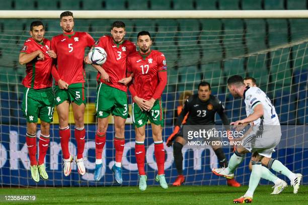 Northern Ireland's midfielder Jordan Thompson takes a free kick during the FIFA World Cup Qatar 2022 qualification group C football match between...