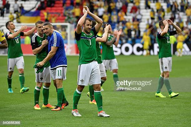 Northern Ireland's midfielder Niall McGinn celebrates his team's win after the Euro 2016 group C football match between Ukraine and Northern Ireland...