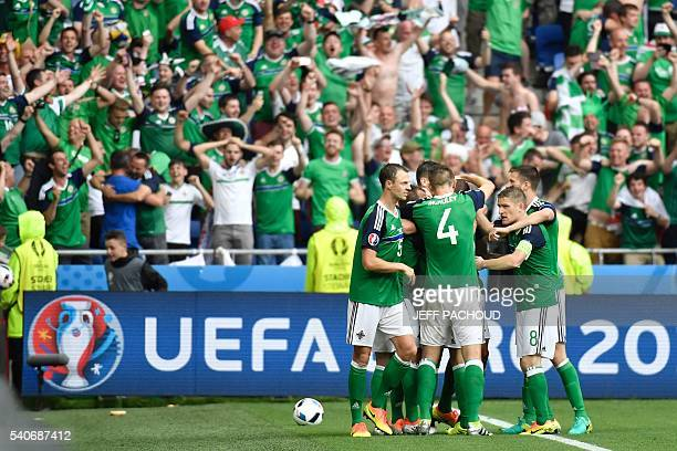 Northern Ireland's midfielder Niall McGinn celebrates scoring a goal with team mates during the Euro 2016 group C football match between Ukraine and...