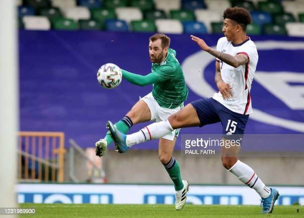 Northern Ireland's midfielder Niall McGinn shoots to score their first goal during the international friendly football match between Northern Ireland...