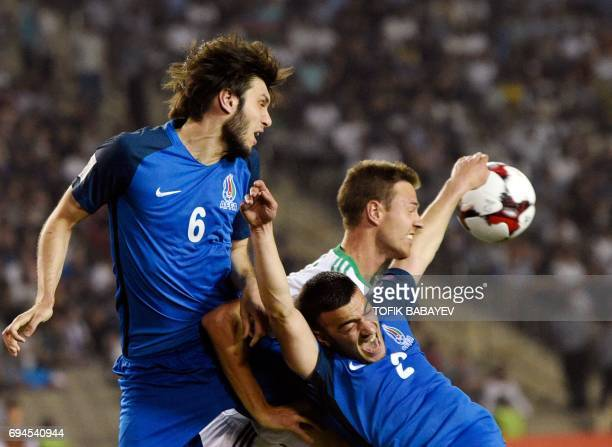 Northern Ireland's midfielder Shane Ferguson vies with Azerbaijani defender Badavi Huseynov and midfielder Gara Garayev during the FIFA World Cup...