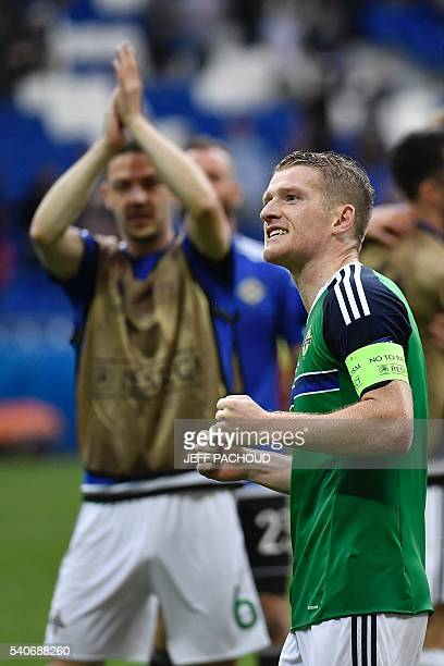 Northern Ireland's midfielder Steven Davis celebrates his team's win after the Euro 2016 group C football match between Ukraine and Northern Ireland...