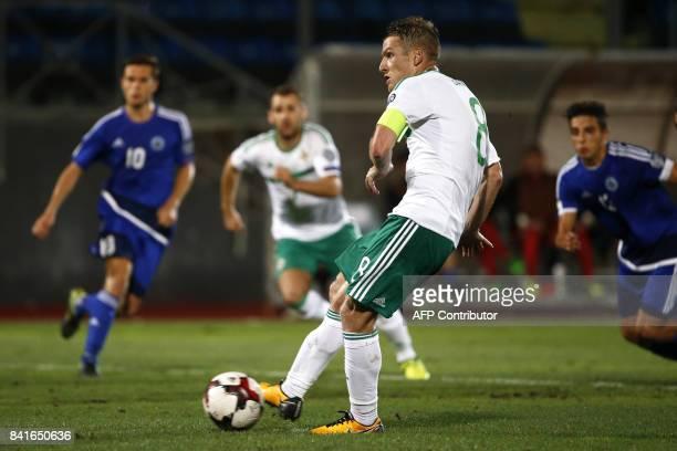 Northern Ireland's midfielder Steven Davis scores a penalty during the 2018 FIFA World Cup qualifying football match San Marino vs Northern Ireland...