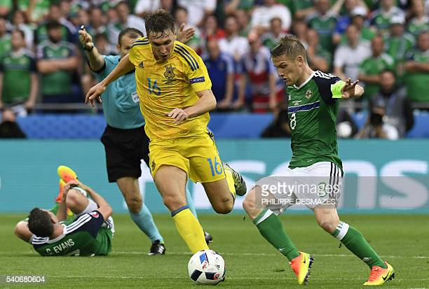 Northern Ireland's midfielder Steven Davis vies for the ball with Ukraine's midfielder Serhiy Sydorchuk during the Euro 2016 group C football match...