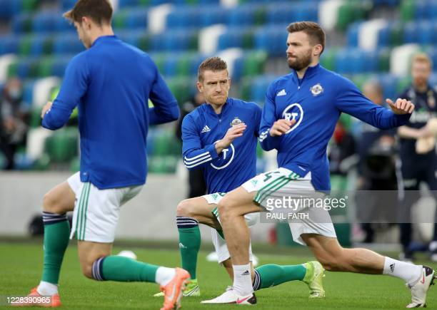 Northern Ireland's midfielder Steven Davis warms up ahead of the UEFA Nations League football match between Northern Ireland and Norway at Windsor...