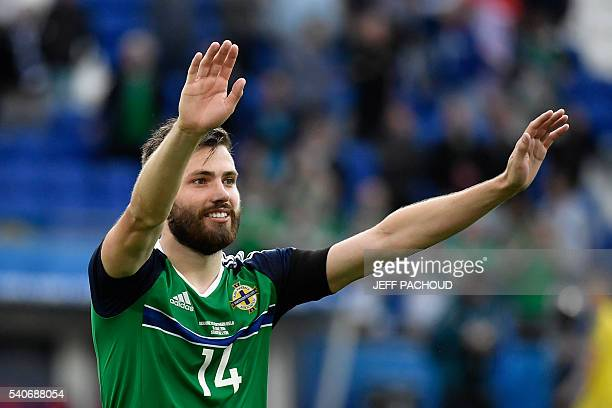 Northern Ireland's midfielder Stuart Dallas celebrates his team's win after the Euro 2016 group C football match between Ukraine and Northern Ireland...