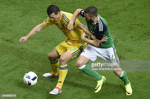 Northern Ireland's midfielder Stuart Dallas vies for the ball with Ukraine's defender Artem Fedetskiy during the Euro 2016 group C football match...