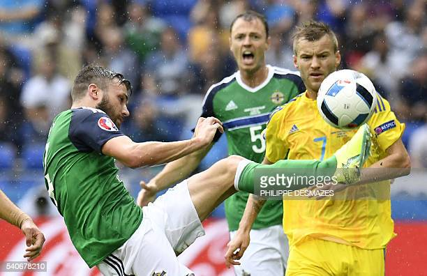 Northern Ireland's midfielder Stuart Dallas vies with Ukraine's midfielder Andriy Yarmolenko during the Euro 2016 group C football match between...