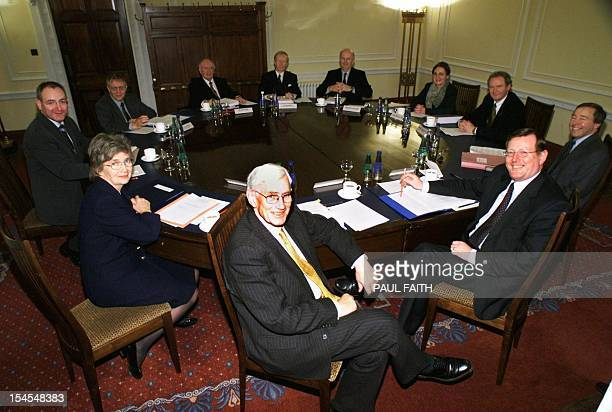 Northern ireland's new power-sharing executive met 02 December 1999 for the first time in Belfast. Seated from clockwise at front, SDLP leaders...