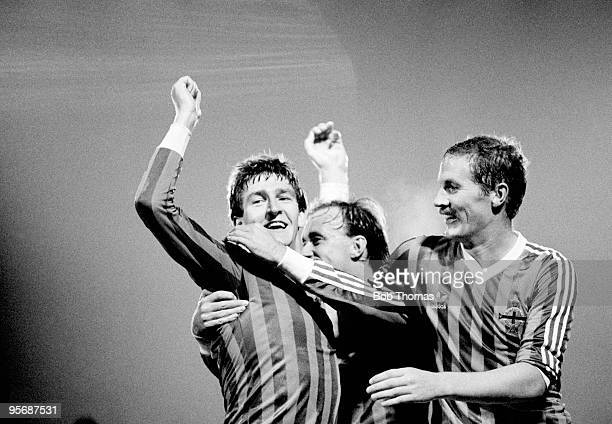 Northern Ireland's Norman Whiteside is congratulated by teammates Sammy McIlroy and Billy Hamilton after scoring his first goal for Northern Ireland...