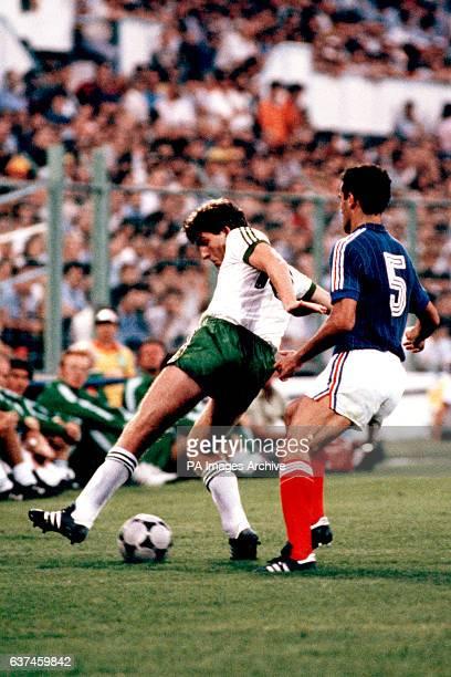 Northern Ireland's Norman Whiteside shields the ball from Yugoslavia's Nenad Stojkovic