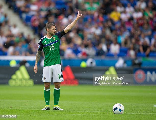 Northern Ireland's Oliver Norwood prepares to take a free kick during the UEFA Euro 2016 Group C match between Ukraine and Northern Ireland at Stade...