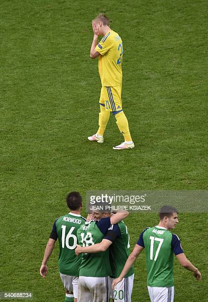 Northern Ireland's players celebrate at the end of the Euro 2016 group C football match between Ukraine and Northern Ireland at the Parc Olympique...