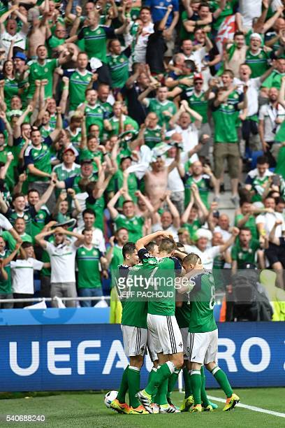 Northern Ireland's players celebrate their team's win after the Euro 2016 group C football match between Ukraine and Northern Ireland at the Parc...