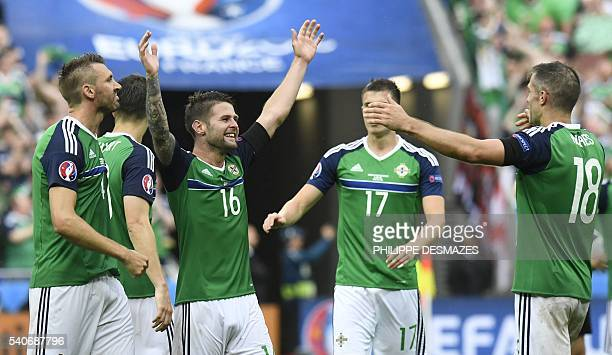Northern Ireland's players celebtate at the end of the Euro 2016 group C football match between Ukraine and Northern Ireland at the Parc Olympique...