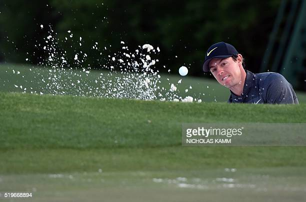 Northern Ireland's Rory McIlroy hits out of a bunker on the 18th green during Round 1 of the 80th Masters Golf Tournament at the Augusta National...