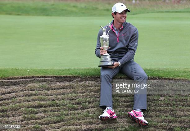 Northern Ireland's Rory McIlroy holds the Claret Jug as his poses for a photograph after winning the 2014 British Open Golf Championship at Royal...