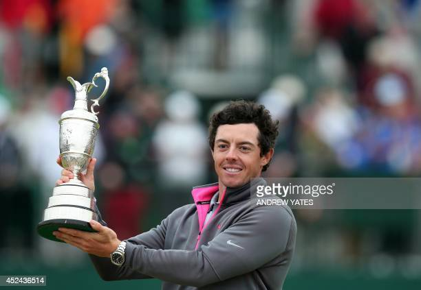 Northern Ireland's Rory McIlroy holds up the Claret Jug after winning the 2014 British Open Golf Championship at Royal Liverpool Golf Course in...