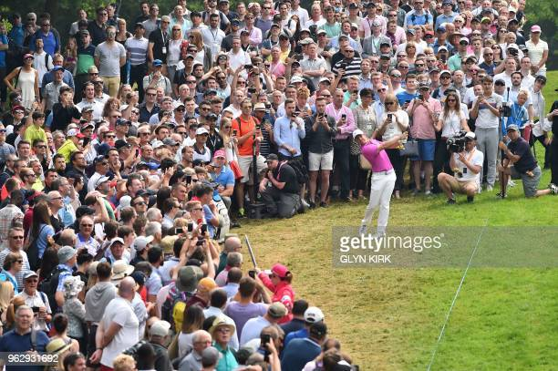 TOPSHOT Northern Ireland's Rory McIlroy plays his second shot on the first on day four of the golf PGA Championship at Wentworth Golf Club in Surrey...