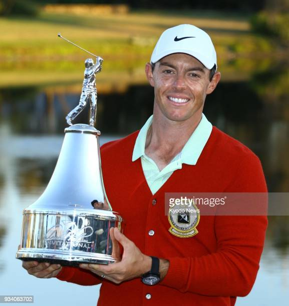 Northern Ireland's Rory McIlroy poses with the trophy after winning the Arnold Palmer Invitational golf tournament on March 18 in Orlando Florida...