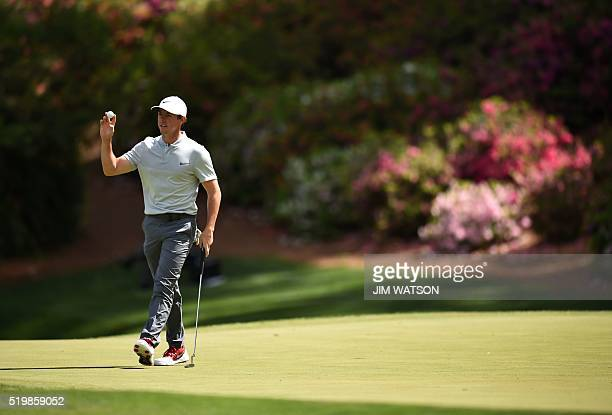 Northern Ireland's Rory McIlroy reacts after putting during Round 2 of the 80th Masters Golf Tournament at the Augusta National Golf Club on April 8...