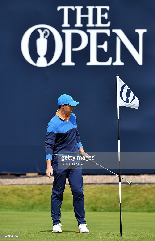 Northern Ireland's Rory McIlroy reacts on the 18th Green during practice on July 12, 2016, ahead of the 2016 British Open Golf Championship at Royal Troon in Scotland. The 2016 British Open begins on July 14, 2016. McIlroy returns to the Open at Troon after being unable to defend his title a year ago in St Andrews when he suffered an ankle injury playing football. / AFP / BEN