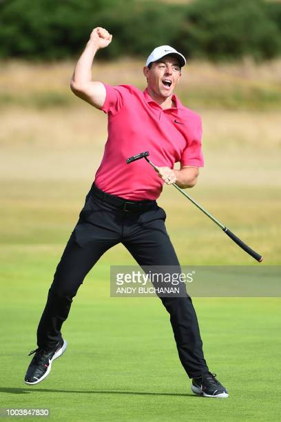 Northern Ireland's Rory McIlroy reacts to making an eagle putt on the 14th green during his final round 70 on day 4 of The 147th Open golf...